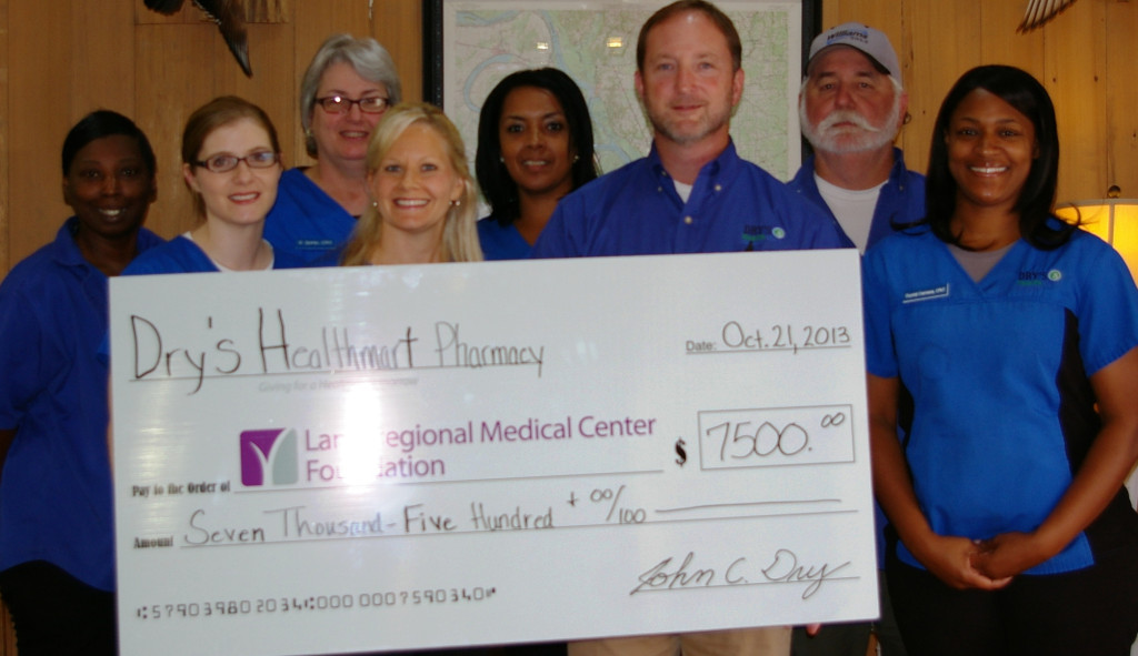 "Dry's Health Mart Pharmacy recently presented a pledge for $7,500 to the LaneRMC Foundation to support its Cancer Services capital campaign project.  This generous donation will go toward the new Radiation Oncology Center that will open on Lane's campus in early 2014. ""I feel it is my responsibility as a healthcare business to give back to such a worthy cause,"" says John Dry, ""especially one that will help the community and many of my customers who will benefit from having a local cancer treatment center."""